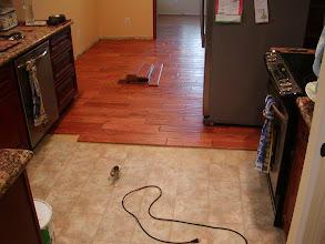 Photo: 3/4 handicapped hardwood installation  over vinyl as moisture barrier.
