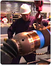 Thumbnail of man in hardhat working on pipe