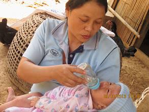Photo: Near Chiang Dao:  Kanda (healthcare volunteer with new born baby)