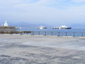 Photo: Some of the oversized yachts which call on the port here.