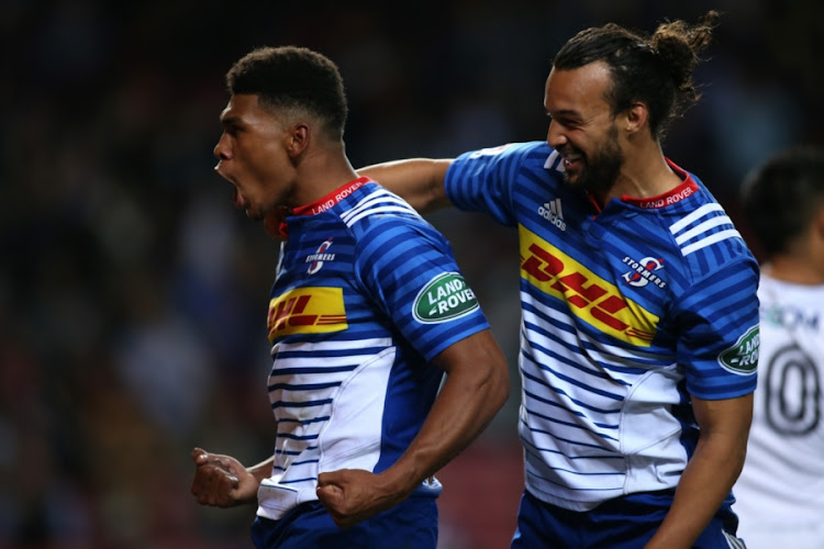 Damian Willemse of the Stormers is congratulated by teammate Dillyn Leyds after scoring a try during the Super Rugby match against Sunwolves at DHL Newlands on July 08, 2017 in Cape Town, South Africa.