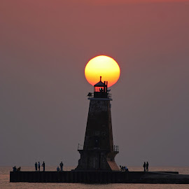Setting Sun by Bill Diller - Buildings & Architecture Other Exteriors ( lake michigan, breakwater, lighthouse, michigan, great lakes, harbor, tranquil, sun, peaceful, calm, north breakwater lighthouse, ludington lighthouse, sunset, calmness, tranquility )