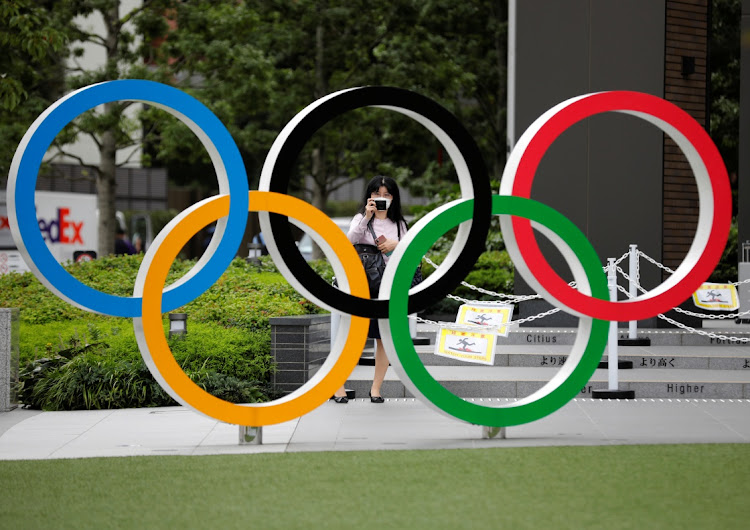 The Olympic rings in front of the National Stadium in Tokyo, Japan