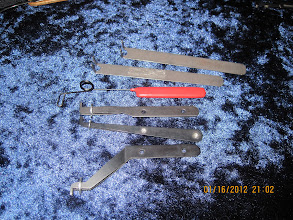 Photo: Dual prong tension wrenches, with one feather-touch wrench (red handle)