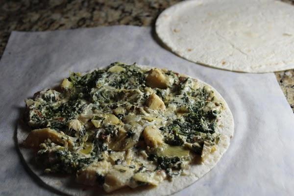 Spread some of the mixture onto a flour tortilla.