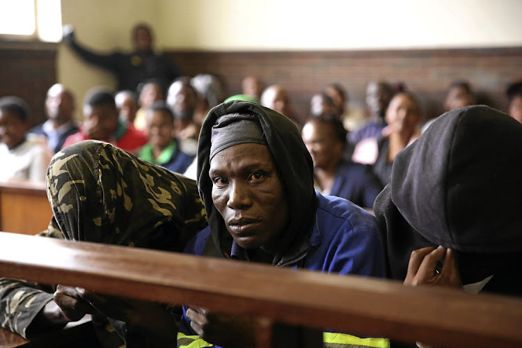 Seven men accused of eating human flesh appeared in the Estcourt Magistrate's Court on Thursday.