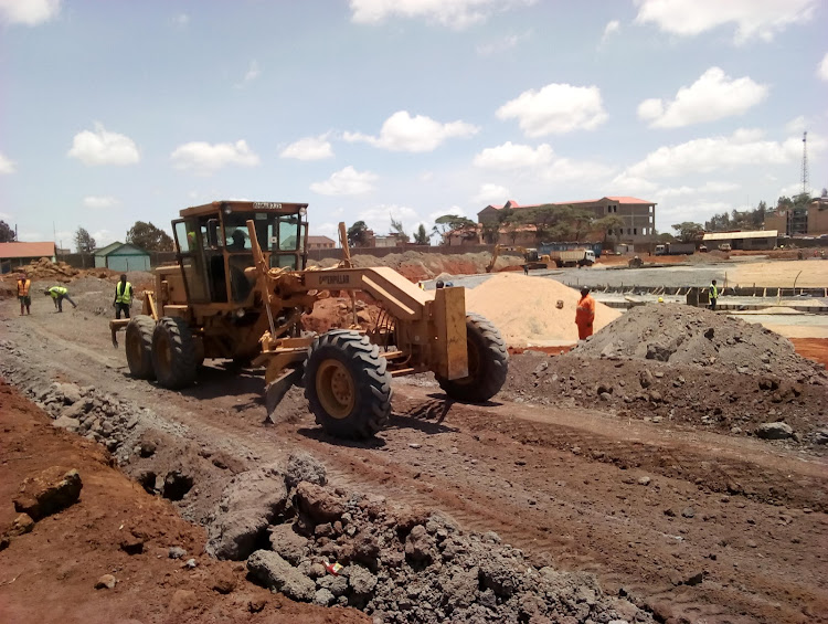 Workers busy at the sanitation section at the proposed ultra-modern Marsabit stadium.