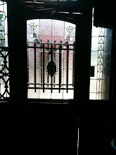 Photo: Old Town Grain and Feed Entry Antique door stained glass, repair. Leaded glass.