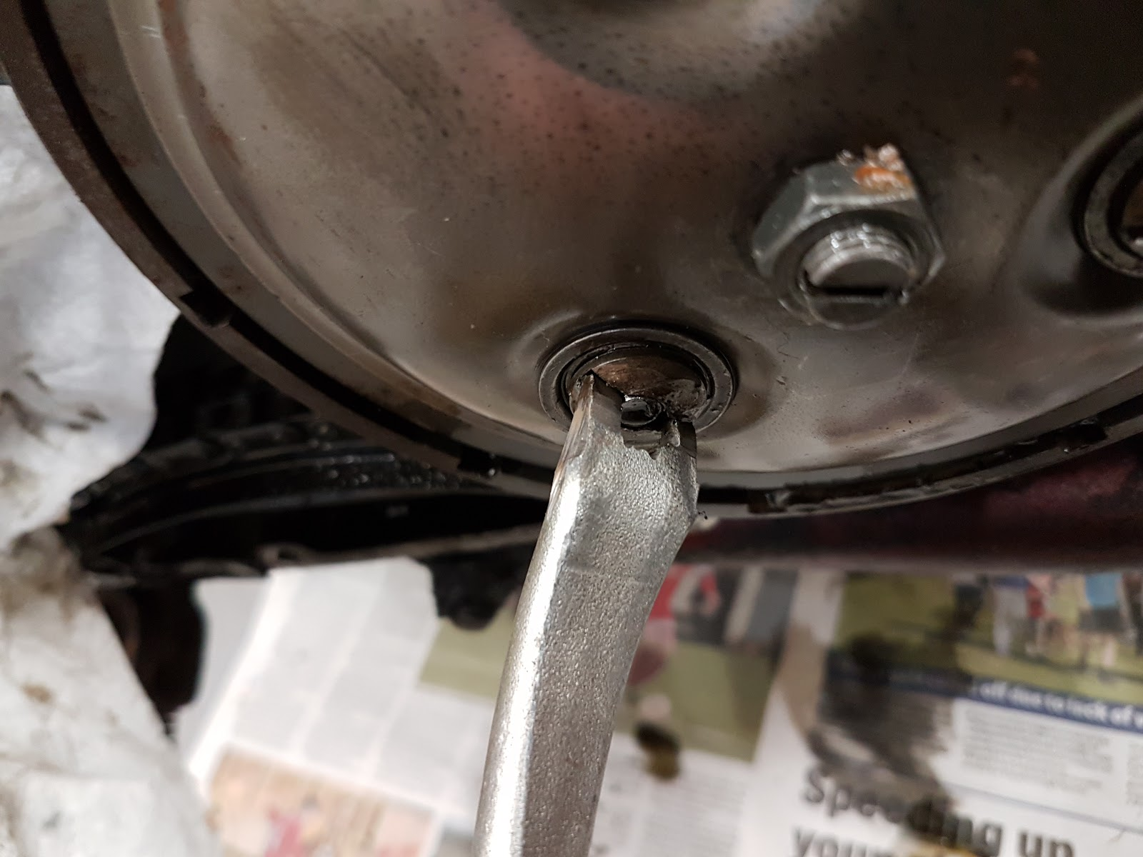Making a special tool to remove the clutch retaining pins from a Triumph Bonneville out of an old tyre lever.