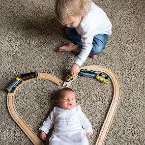 Baby Portrait by Mike Lesnick - Babies & Children Babies ( baby portrait, toy train, baby,  )