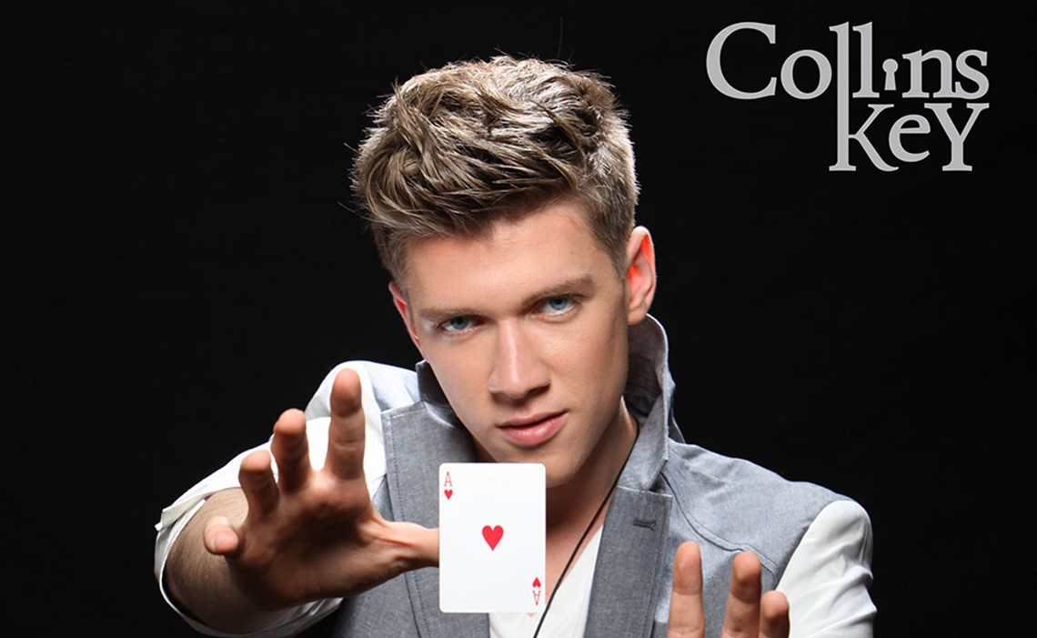 Collins Key levitating the Ace of Hearts card.