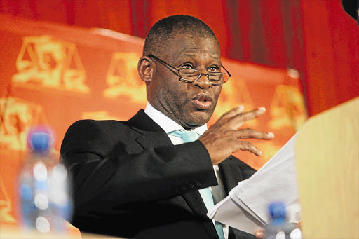 Mokotedi Mpshe, as National Prosecuting Authority acting head in 2009, announces his decision to drop corruption charges against Jacob Zuma