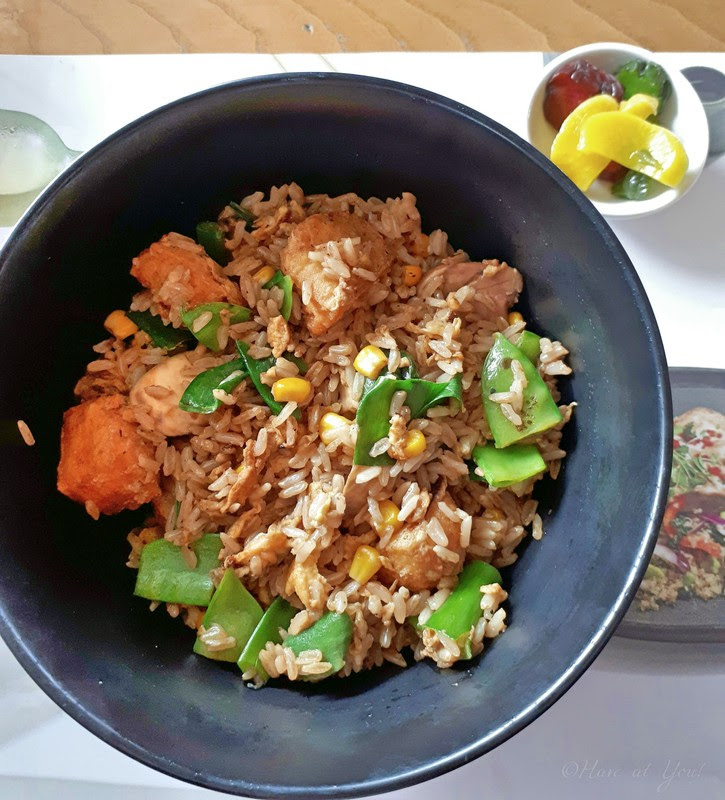 a bowl of Japanese fried rice with tofu and vegetables
