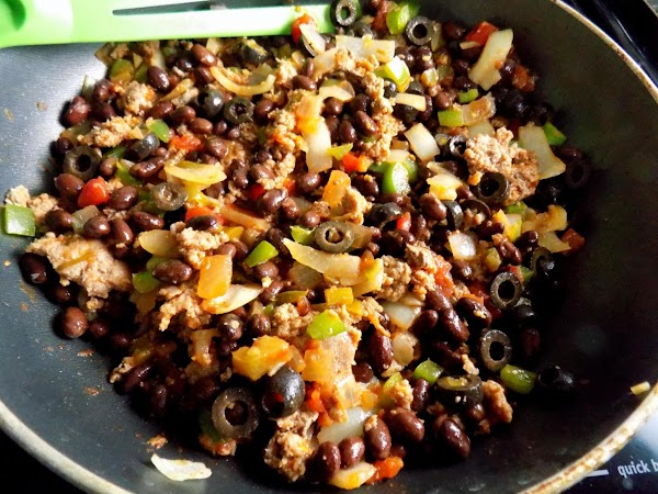 While oven heats, brown ground meat, mixing in onions and bell peppers as you...
