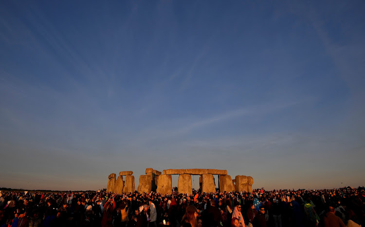 Revellers welcome in the Summer Solstice at Stonehenge stone circle in southwest Britain.