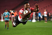 Wandisile Simelane of the Golden Lions scores a try during the Currie Cup match against the Griquas at Ellis Park on August 24, 2018 in Johannesburg, South Africa.