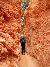 Photo: Aaron slinks through a narrow passageway on the trail.