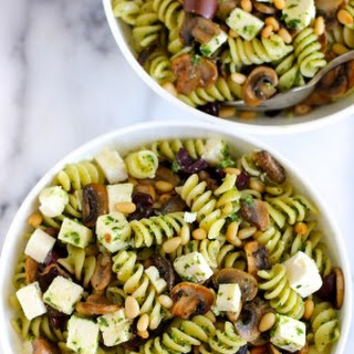 Pasta with Mushrooms Olives Feta and Pesto.