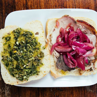 Porchetta Sandwiches with Marinated Onions and Salsa Verde.
