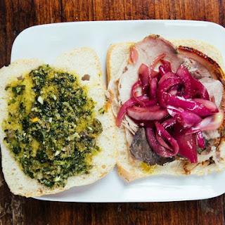 Porchetta Sandwiches with Marinated Onions and Salsa Verde.