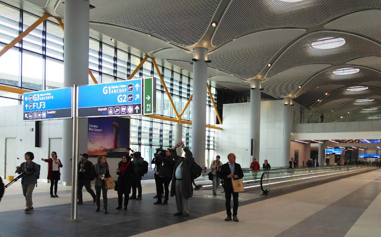 Journalists from around the world inspect Istanbul New Airport before its opening on Monday.