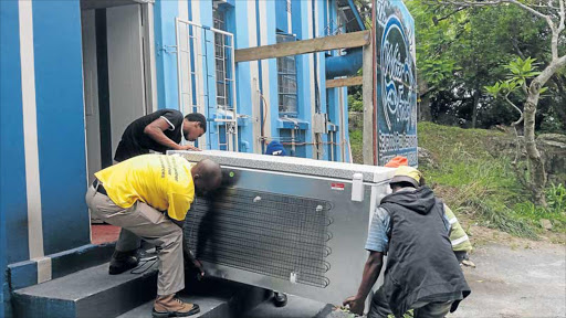 CONFISCATED: Members of the public allegedly helped government officials remove a freezer full of 272 crayfish from the Waterfront Restaurant in Port St Johns despite it being legally bought from a company that has a permit to buy from Wild Coast subsistence fishermen Picture: SUPPLIED