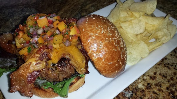 Construct burger: bun, mixed greens, burger patty, and top it with the habanero stone...
