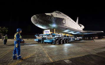 Photo: The driver of the Over Land Transporter is seen as he maneuvers the space shuttle Endeavour on the streets of Los Angeles as it heads to its new home at the California Science Center, Friday, Oct. 12, 2012. Endeavour, built as a replacement for space shuttle Challenger, completed 25 missions, spent 299 days in orbit, and orbited Earth 4,671 times while traveling 122,883,151 miles. Beginning Oct. 30, the shuttle will be on display in the CSC's Samuel Oschin Space Shuttle Endeavour Display Pavilion, embarking on its new mission to commemorate past achievements in space and educate and inspire future generations of explorers. Photo Credit: (NASA/Bill Ingalls)