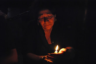 Photo: A woman mourns the lives lost during the Maspero massacre days earlier.