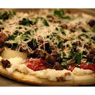 Elk Italian Sausage Pizza With Ricotta Cheese, Sautéd Mushrooms and Onion.