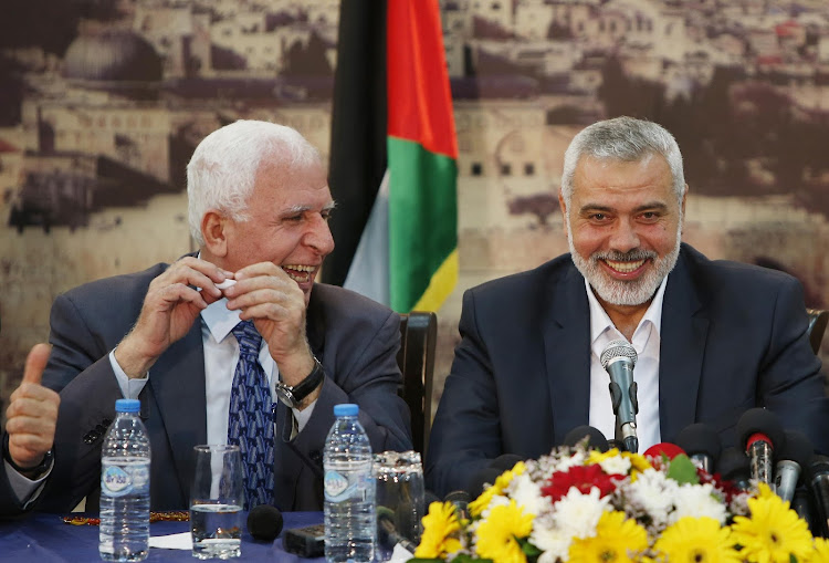 Head of the Hamas government Ismail Haniyeh and Senior Fatah official Azzam Al-Ahmed (L) attend a news conference as they announce a reconciliation agreement in Gaza City. Picture: REUTERS