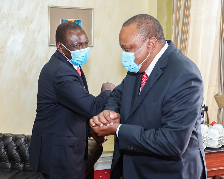 President Uhuru Kenyatta and Deputy President William Ruto at State House, Nairobi during Madaraka Day celebrations on June 1, 2020.