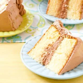 Yellow Birthday Cake with Fluffy Chocolate Ganache Frosting.