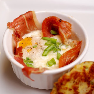Baked Eggs with Prosciutto and Parmesan.