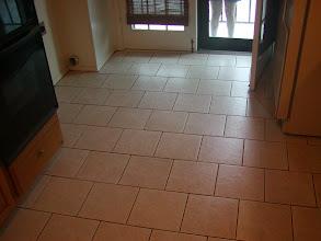Photo: brick pattern installation in condo kitchen floor.