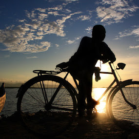 boat n bycycle by Adhy Winata - People Portraits of Men