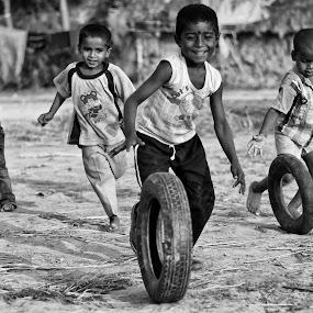 play with wheel by  Bivahasutra Wedding Photography - Babies & Children Children Candids ( bangla, wheel, kolkata, westbengal, asia, children, india, bengali, indianchildren )