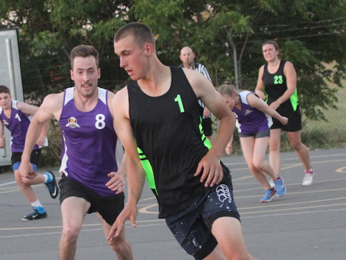 Sliced Bread's Zac Lauritsen, right, charges towards the hoop while being chased by Namoi Hotel's Tom Mackey, left.