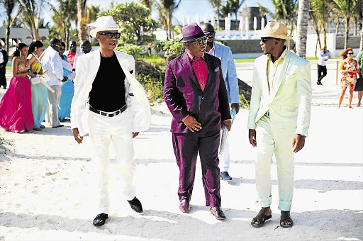 Julius Malema with former mayor of Capricorn district municipality Lawrence Mapoloe and his former business partner at SGL Engineering, Lesiba Gwangwa, at the multi-million-rand wedding of property developer David Mabilu to Phala Mokgophi in Mauritius. File photo.