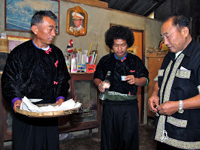 Photo: shaman and helpers preparing to perform the welcome ceremony