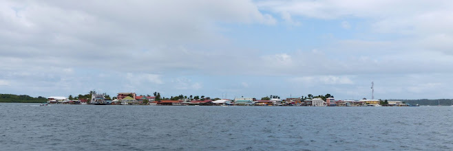 Photo: Rounding the corner, the much more densely populated Bocas Town, on Isla Colon.