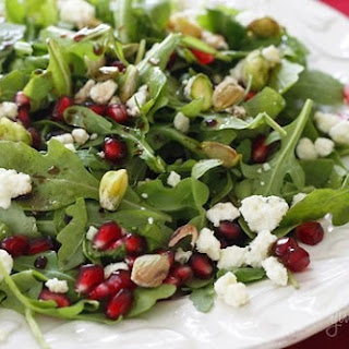 Arugula with Pomegranates, Blue Cheese and Pistachios.