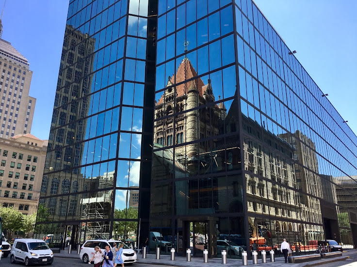 The reflection of Trinity Church in the glass facade of the Hancock.