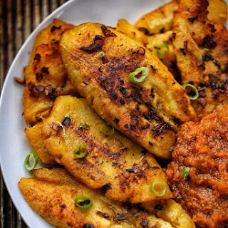 Crispy Pan fried plantains with pepper sauce.