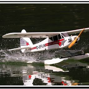 by AB Rossouw - Transportation Airplanes ( water, reflection, airplane, transportation )