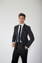 Photo: Grey wool suit with navy spot pocket square and navy silk tie