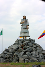 Photo: As we make our way back to Daule, we pass by the statue of Saint Narcisa.  It stands on the rotary at the entrance to Nobol.  We have passed it twice a day, most every day!