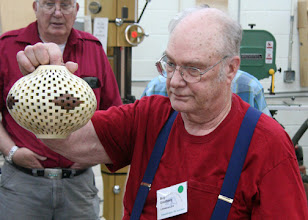 Photo: Bob Grudberg talking about his open segmented hollow vessel.