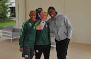 Caster Semenya poses for a photograph with Banyana Banyana forward Busisiwe Ndimeni and Janine van Wyk during the 2019 Fifa Women's World Cup in France in June.