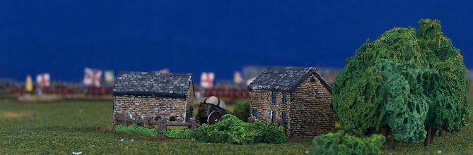 Photo: La fattoria posta all'estremità sud-occidentale del campo di battaglia.Miniature Baccus, materiale scenico TimeCast e autocostruito.